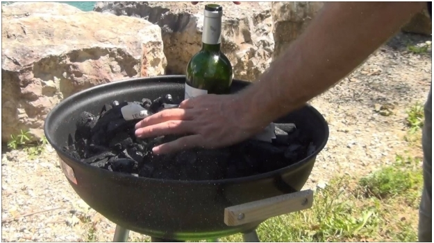 Putting out charcoal grill